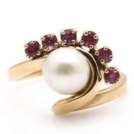 18K Yellow Gold Ruby and Pearl Ring: An 18K yellow gold ruby and pearl ring.