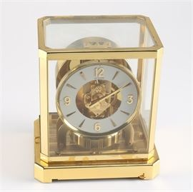 """Jaeger Le Coultre """"Atmos"""" Mantel Clock: A Jaeger LeCoultre Atmos mantel clock, circa 1960's-1970's. The clock features a brass frame and buss with glass sidings, exposing the clock part interior. The clock has fifteen jewels and was made in Switzerland."""