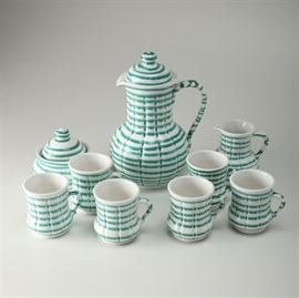 """Austrian Gmundner """"Green Stripe"""" Coffee Set: An Austrian Gmundner Green Stripe coffee set. This collection includes nine pieces in the Gmundner Green Stripe pattern featuring blue horizontal stripes circling each piece. Includes one coffee pot, one sugar bowl, one creamer, and six coffee cups. Each piece is marked to the underside reading """"Spulmaschinengeeignet Handdemalt, Gmundner, Keramik, G5W, Made in Austria""""."""