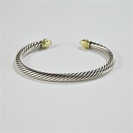 David Yurman Cable Classic Bracelet: A David Yurman cable classic 14K yellow gold and sterling bracelet with peridots.