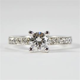 1.19 CTW Tacori Engagement Ring: A 1.19 ctw Tacori engagement ring. This classic ring features a round brilliant cut diamond in a four prong setting with accent diamonds on the upper shank.