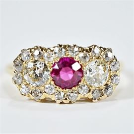 Vintage 1.18 CTW Diamond Ring: A vintage 1.18 ctw diamond and synthetic ruby ring set in a 14K yellow gold setting.