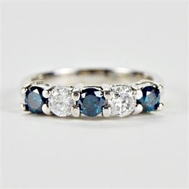 White and Blue Diamond Band: A white and irradiated blue diamond band in a shared prong setting.
