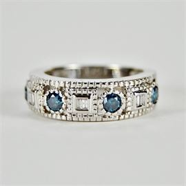 Antique Style Diamond Band: An antique style white and irradiated blue diamond band set in 14K gold.