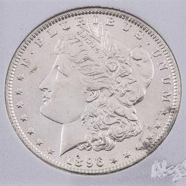 1896 Silver Morgan Dollar: An 1896 silver Morgan dollar. Designer: George T. Morgan. Mintage: 9,976,000. Metal content: 90% silver, 10% copper. Diameter: 38.1 mm. Weight: 26.7 grams. Very good condition.
