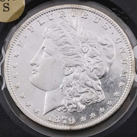1879 S Silver Morgan Dollar: An 1879 S silver Morgan dollar. Designer: George T. Morgan. Mintage: 9,110,000. Metal content: 90% silver, 10% copper. Diameter: 38.1 mm. Weight: 26.7 grams. Good condition. Scratch to the face.