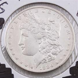 1884 S Silver Morgan Dollar: An 1884 S silver Morgan dollar. Designer: George T. Morgan. Mintage: 3,200,000. Metal content: 90% silver, 10% copper. Diameter: 38.1 mm. Weight: 26.7 grams. Very good condition.