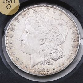 1881 O Silver Morgan Dollar: An 1881 O silver Morgan dollar. Designer: George T. Morgan. Mintage: 5,708,000. Metal content: 90% silver, 10% copper. Diameter: 38.1 mm. Weight: 26.7 grams. Circulated. Very good condition.