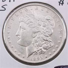 1891 S Silver Morgan Dollar: An 1891 S silver Morgan dollar. Designer: George T. Morgan. Mintage: 5,296,000. Metal content: 90% silver, 10% copper. Diameter: 38.1 mm. Weight: 26.7 grams. Very good condition.