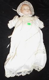 13 Porcelain Head Doll, Hands Porcelain, Body Fabric name not legible