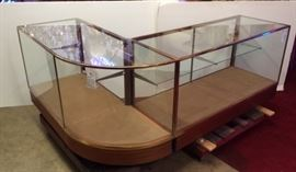 Bronze and wood curved glass showcases