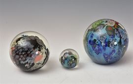 """Two Josh Simpson Art Glass Paperweights including 4"""" high Mega Planet together with a Josh Simpson marble all signed"""