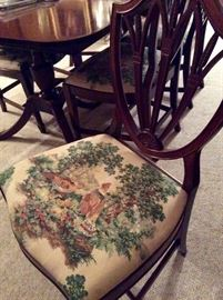Tapestry chairs on a beautiful Duncan Phyfe Dining Room set.
