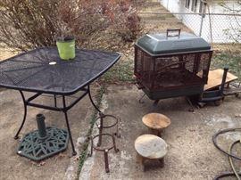 Umbrella table, umbrella stand, Coleman fire pit, plant stands