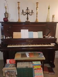 Upright piano early 1900s, candelabras, music books, & more.