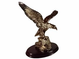 SILVER METAL OVERLAY SCULPTURE OF AN EAGLE