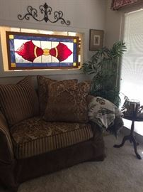 over size love seat & stain window