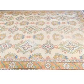 Antique Turkish Chichi Room Size Rug: A hand knotted antique Turkish Chichi room size rug. The wool and cotton rug features a cream background with blue, deep rose, ochre borders and pattern with burgundy accents. The primary border is woven in a Chichi design. It has cotton warp fringe and is unmarked.