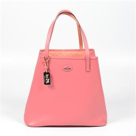 Coach Saffiano Leather Park Dream Tote: A Coach Saffiano leather Park Dream tote. This tote is two-toned with Saffiano leather in loganberry and coral, and has double handles with a double hook closure. The bag is complete with silver toned hardware, and interior zip pocket, and two slip pockets. The creed to the interior reads No B1421-32701 and includes the silver toned metal Coach tag attached and dust bag.