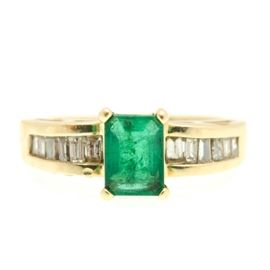 14K Yellow Gold 0.50 CTW Diamond and 0.90 CT Emerald Ring: A 14K yellow gold 0.50 ctw diamond and 0.90 ct emerald ring.