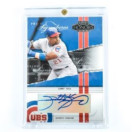 """Encased Authenticated Sammy Sosa Autograph: A Prime Signatures encased 2004 Sammy Sosa autograph. The authenticated signature is numbered 50/50. It is presented in plastic case and labeled, """"Playoff Honors 2004""""."""