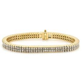 18K Yellow Gold Diamond Tennis Bracelet: An 18K yellow gold diamond tennis bracelet.