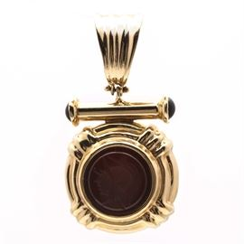 14K Yellow Gold Carnelian Intaglio Pendant: A 14K yellow gold carnelian intaglio pendant. This pendant also features black onyx accents.