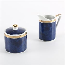 """Otagiri """"Lapis"""" Sugar and Creamer: A Lapis by Otagiri sugar and creamer. They feature royal and dark blue cylindrical exteriors with black and gold gilt bands. The sugar bowl features a lid with a knob handle. The undersides are marked, """"Lapis/ Otagiri Japan."""""""