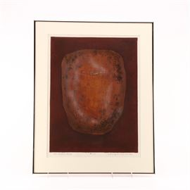 Aquatint Etching on Paper of an Artifact: An aquatint etching on paper. This print depicts an artifact in red, orange, brown, grey, and black shades. The piece is hand signed by the artist to the lower right corner. It is presented behind an off-white mat behind glass in a metal frame.