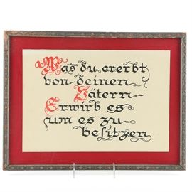 "Framed Calligraphy of Johann Wolfgang von Goethe Quote From ""Faust"": A framed German calligraphy piece drawn on paper. Featured is a quote from notable German author Johann Wolfgang von Goethe, hand-rendered in red and black inks. The quote, from Goethe's play Faust, reads, ""Was du ererbt von deinen Vätern hast, erwirb es, um es zu besitzen"". This translates to ""What you have inherited from your fathers, acquire it to possess it."" The piece is presented over a red background; set under glass in a decorative wooden frame with wire to the back for hanging."