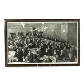 1929 Photograph of Master Farmer Banquet: A framed photograph of the second annual Master Farmer Banquet on December 12th, 1929 by Century. This depicts a ballroom at the Hotel Lincoln in New York City, with a long trestle head table, and round banquet tables full of men in dark suits and a few women in evening dress. It is titled in the bottom right corner, and attributed in the bottom left. This work is presented under glass in a dark wooden frame, wired for hanging.