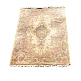 Belgian Hand Made Area Rug: A Belgian hand made area rug. It has a pale pink base with a floral motif. It is hand knotted and dated circa 1840.