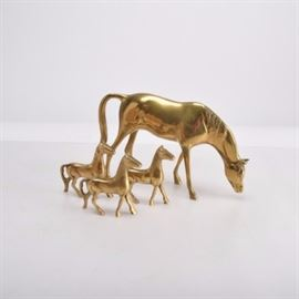 Family of Brass Horses: A family of horses in brass. Included is a large horse and three small foals.