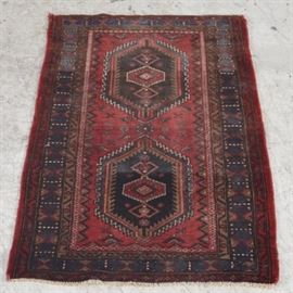 Vintage Hand Knotted Kurdish Bidjar: A vintage hand-knotted Kurdish Bidjar runner. The wool rug has a center lozenges surrounding two medallions woven on a black background. The center lozenges rest on a red field surrounded by three borders with geometrical designs.