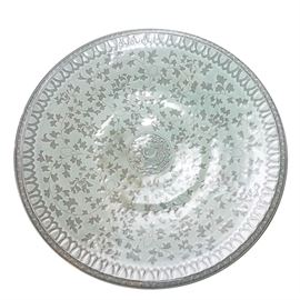 Hand Thrown Korean Ceramic Bowl: A hand thrown Korean ceramic bowl. This bowl features a hand-painted phoenix in the center of the bowl with an ivy leaf pattern throughout and a painted scallop edge on an aqua colored background. The bowl has a maker's mark to the underside.