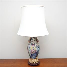 Capodimonte Style Table Lamp: A table lamp. This selection includes a ceramic base with colorful foliates, figural birds, and gilt accents. Also featured are intentional craquelure, one socket, and a white shade.
