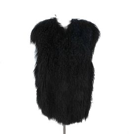 "Black Mongolian Lamb Fur Vest: A black Mongolian lamb fur vest. This long vest features a V-neck, a body of long curly lamb hair and a full satin lining. This vest is tagged to the interior ""M""."