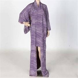 Lavender Kimono: A lavender komon kimono. The piece has a small collar, sleeves and a floor length design. The fabric features lavender and white horizontal stripes throughout the design. The kimono is unmarked.