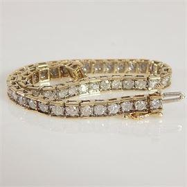 10K Yellow Gold Diamond Tennis Bracelet: A 10K yellow gold diamond tennis bracelet.