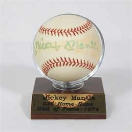 """JSA Authenticated Signed Mickey Mantle Baseball: A baseball signed by Major League Baseball's Hall of Fame Mickey Mantle, on a wood base with plaque that reads """"Mickey Mantle 536 Home Runs Hall of Fame – 1974"""". The signature appears to the sweet spot, on a game used Official Ball of the American League, Bobby Brown President."""