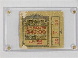 """1927 Gene Tunney vs. Jack Demsey """"Long Count"""" Fight Ticket Stub: A ticket stub, encased in acrylis case, from the World Heavyweight Championship Prizefight held at Soldier Field, Chicago, September 22, 1927. The fight, became known as """"The Long Count Fight"""", with a newly ushered set of rules delaying the count of the knockout to start until the opposing fighter is in his corner. When Tunney was down, Dempsey delayed in going to a neutral corner, delaying the outcome of the fight. The ticket shows some damage, but is securely encased in acrylic case."""