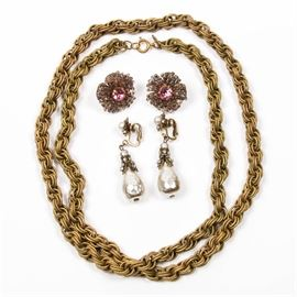 """Miriam Haskell Earrings and Necklace: A collection of Miriam Haskell earrings and a necklace. Included is a matte gold tone multi-link chain necklace, eighteen inch long. Also included are a pair of lever back earrings with a pink center stone surrounded by small beads, and a pair of faux pearl teardrop and rhinestone earrings with lever backs. All pieces are marked """"Miriam Haskell""""."""