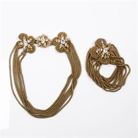 """Miriam Haskell Necklace and Bracelet: A Miriam Haskell necklace and bracelet. Featuring a matching gold tone necklace and bracelet set. Both pieces are multi-strand styles with box clasps and floral and rhinestone embellishments. They are marked """"Miriam Haskell"""" on the clasps."""