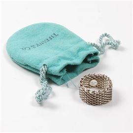 Tiffany & Co. Sterling Mesh Band Ring: A Tiffany & Co. sterling silver mesh band ring. The ring comes with a light blue Tiffany drawstring bag.