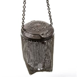 Antique Silver Plated Mesh Coin Purse: An antique silver plate mesh purse. The purse features a rolo chain handle, and a woven metal mesh bag, which is attached to an ornate collar. The collar has a hinged lid attached, which features repousse flower designs around the top. No maker's marks.