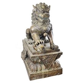 Antique Bronze Guardian Lion Statue: An antique bronze guardian lion statue. This bronze statue from circa 1790-1820 depicts an ornately detailed guardian lion with fore-paw on a lion cub and sits on a beveled rectangular pedestal with scalloped motif base.