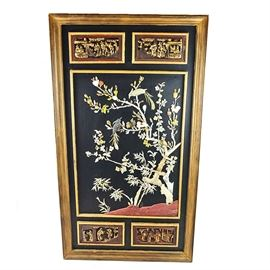 Large Chinese Panel With Applied Carved Birds and Branches: A large Chinese panel with applied carved birds and branches. This rectangular wall hanging features a beveled wood frame, four carved panels, two on the top and two on the bottom, with raised gold tone scenes on red backgrounds and a central black panel with applied mother of pearl and mineral birds and branches. Panel has a black back with hand painted landscape of mountains and trees.
