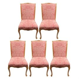 EJ Victor Louis XV Dining Chairs: A set of five EJ Victor upholstered Louis XV dining chairs. The chairs have a light oak wood frame with a floral carvings to the rails and skirts. Each chair is upholstered with a light red upholstery and rests on four cabriole legs.