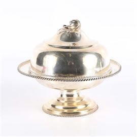 """A Rumrill & Co. Coin Silver Covered Dish: An A. Rumrill Co. coin silver covered dish. The piece features a lid topped with a fruit, a slotted center and a footed base accented with a rope edge. The piece is marked """"A. Rumrill & Co. Coin 284 B-Way NY"""" to the base. The total approximate weight is 17.455 ozt."""