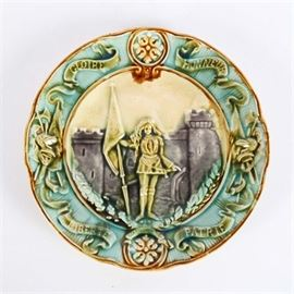 """Vintage French Majolica Plate: A vintage French Majolica ceramic plate. The plate reads, """"Gloire Honneur Liberte Patrie"""" to front with an image of a soldier holding a flag."""